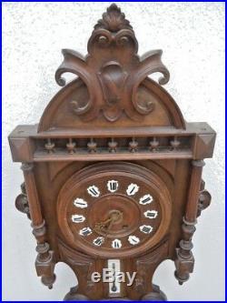 Pendule horloge bois sculpte sculpture foret noire barometre thermometre