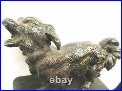 Sculptures, Serre-livres en fonte de fer à patine couleur bronze les CHIENS